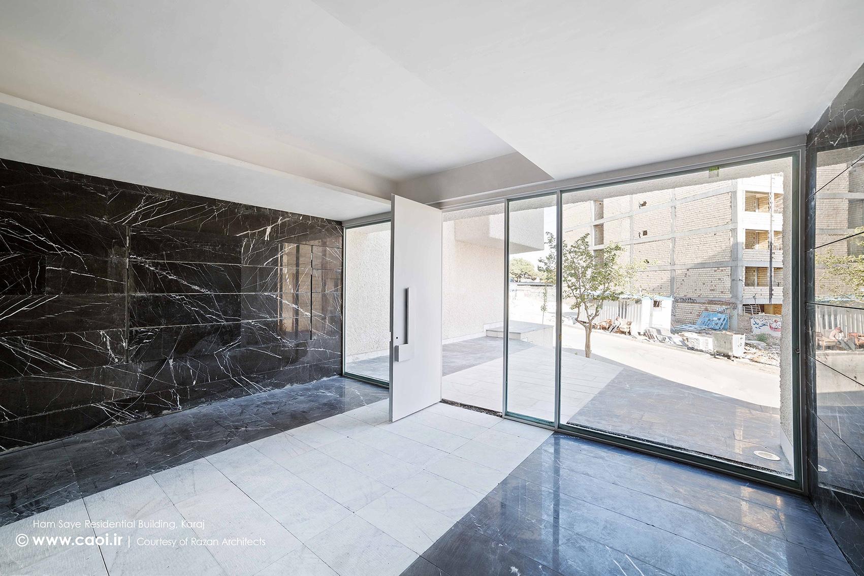 ورودی مجتمع مسکونی,نمای ساختمان مسکونی همسایه,نمای مجتمع مسکونی,طراحی نمای مجتمع مسکونی